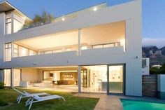 Architecture, Hotel Guesthouse Villa Modern Camps Bay Home Designs Ideas Guest Bedroom Interiors Lighting Furniture Sofa White Wall Lamp Pool Storey Bed Chair Exterior Grass Room Glass Wall: Welcoming Two-In-One Guest Home In Camps Bay