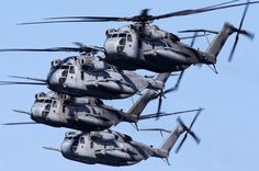 Four USMC CH-53E Super Stallions in formation at NAS North Island