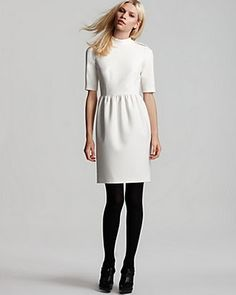 I love white dresses with black tights and shoes.