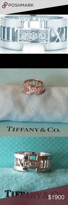Authentic Tiffany Ring w/ Diamonds. Streamlined and modern, the Atlas collection shines with graphic sophistication and bold simplicity. A trio of dazzling diamonds enhances this ring's captivating elegance. 18k white gold with round brilliant diamonds.  Gently worn. In perfect condition. The ring is maintained and professionally polished at Tiffany. With the holidays around the corner bring a smile to her face with Tiffany. Ring Size 7.5 *Authentication by Poshmark Concierge Tiffany & Co…