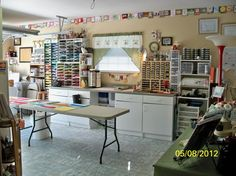 "How to make over the garage. I see some GREAT storage ideas here for my ""small"" craft room."