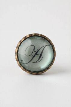 Cursive Knob  anthropologie.com $12.00  These would be a cute little added touch.