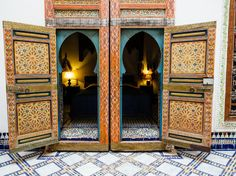 Stately and ornate, Riad Idrissy's hand-painted doors are one of the centerpieces of the open, triple-story courtyard. The doors open in multiple ways—those inner, arched frames swing out too—which helps to regulate heating and cooling in each salon.
