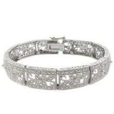 @Overstock - Add an elegant accent to any outfit with this beautiful sterling-silver filigree bracelet. Its flower design is set with white diamonds for extra style, and it is plated with rhodium to resist tarnish, so you won't have to polish it often.http://www.overstock.com/Jewelry-Watches/Sterling-Silver-1-10ct-TDW-Diamond-Filigree-Flower-Bracelet-I-J-I2-I3/5217924/product.html?CID=214117 $69.99