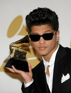 """Bruno Mars with his trophy for Best Male Pop Vocal Performance (""""Just the Way You Are"""") at the Annual Grammy Awards. this is Bruno Mars' one and only Grammy, which is a sin. Bruno Mars, Mark Salling, Rachel Mcadams, Ryan Gosling, Bradley Cooper, Amanda Seyfried, Blake Lively, Beyonce, Taio Cruz"""