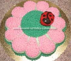 Decided! This I love for TMP's first birthday cake, she is our little lady bug born on the first day or spring. It's made from an 8 inch round cake and 12 cupcakes.