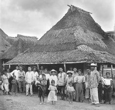 Villagers posing for a stranger and his camera in front of a country store. Paranaque City (South of Manila), Philippines, Early 20th Century