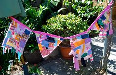 Making pretty bunting from scrap material and glue.