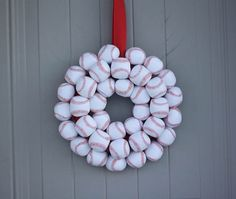 Baseball Wreath DIY: To mark opening day / http://www.oopsicraftmypants.net/2012/03/checkin-in-and-baseball-wreath.html