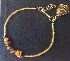 Bracelete Charm Olho de Tigre Caged
