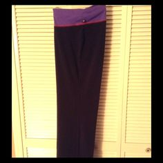 "Plus Size 26/28 Yoga Pants Plus Size 26/28 black yoga pants with purple fold over waist band. Inseam is about 31"". Lane Bryant Pants Wide Leg"