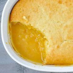 Lemon Pudding Cake - an ultimate lemon comfort food dessert that combines a tasty lemon cake baked on top of a tart, tangy, but not too sweet lemon sauce.
