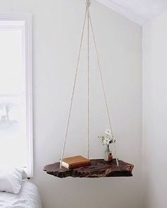 This hanging bed side table is a perfect use of a natural material www.etsy.com/uk/shop/EdwardsAndHawkins #edwardsandhawkins #bedroom #table #wood #handmade #homeware #homedecor #interior #interiordesign