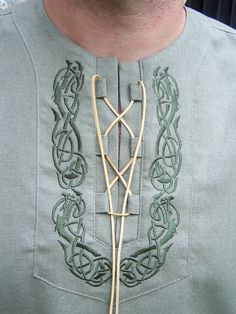 The ties look neat and elegant. If i were to include a neck lace, i would want it to take this form. Viking Tunic, Medieval Tunic, New Saree Designs, Mens Kurta Designs, Medieval Dress Pattern, Tunic Pattern, Neck Designs For Suits, Dress Neck Designs, Black Men Street Fashion