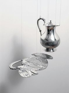 Cornelia Parker, alter egoAlter Ego (Coffee with Unconscious) , 2012 Two silver-plated objects, one flattened by a 250 ton press, suspended on metal wire 7 × 18 × 10 in 19 × × 27 cm Op Art, Cornelia Parker, Sculpture Art, Sculptures, Street Gallery, A Level Art, Everyday Objects, Land Art, Installation Art