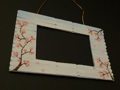Easy way to frame art with Popsicle sticks.