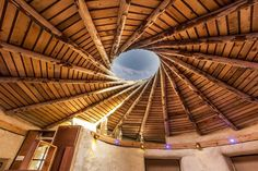 Unique Spiral Straw Bale Studio with a reciprocal roof,dome sky light and living roof. Bamboo Structure, Timber Structure, Round Gazebo, Smurf House, Gazebo Roof, Bamboo House Design, Wooden Gazebo, Eco Buildings, Backyard Studio