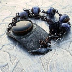 Blackbird - Etched and Patinaed Copper, Recycled Sari Silk and Glass Bracelet - Jewelry creation by Molly Alexander Copper Jewelry, Glass Jewelry, Wire Jewelry, Jewelry Bracelets, Blackbird Singing, Broken Wings, Sari Silk, Wire Wrapped Jewelry, Wire Wrapping