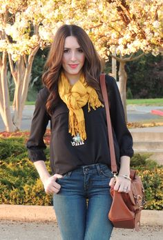 Yellow scarf, black blouse, jeans, brown leather bag