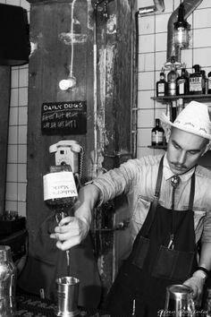 Bartender prepairing the Georgia Mint Julep at 100 Dogs & Bourbon.