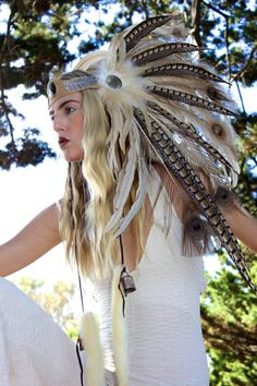 Feather Headdress perfect for the festival season. We love this unique piece at wonderland wigs. #FeatherHeaddress #FeatherHairpiece #FeatherHeadBand #Festival #FestivalHair #FestivalHairAccessory #Summer #Hair
