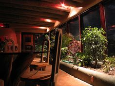 We like the indoor cob planter and beams. Hybrid planter night by Earthship Kirsten, via Flickr