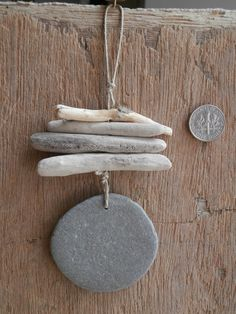 Handmade beach decor 'Driftwood Danglers' with huge flat beach English beach pebble.use for wind chime Driftwood Jewelry, Driftwood Projects, Driftwood Art, Driftwood Mobile, Beach Crafts, Diy And Crafts, Arts And Crafts, Pebble Art, Pebble Beach