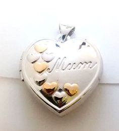 Mum opening heart locket £32