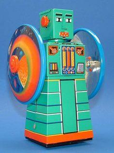 Wheeling Disk Robot Tin Toy