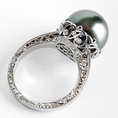 michael beaudry pearl ring. this with a white pearl, rather than black. oh lord, gorgeous.  YES PLEASE