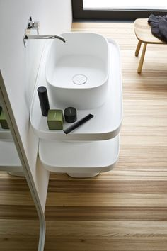 Design wall-mounted Corian® washbasin Fonte Collection by Rexa Design @rexadesign