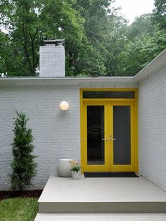 bright yellow door on an atomic ranch