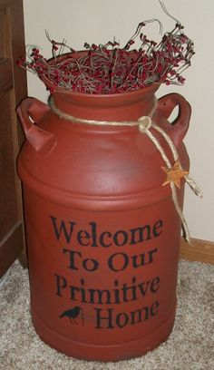 "I spray painted it with ""Flat Red,"" added some berries, jute rope, a rusty star, and stenciled the saying on the front. Prim Decor, Rustic Decor, Farmhouse Decor, Primitive Crafts, Country Primitive, Country Crafts, Country Decor, Old Milk Cans, Milk Jugs"