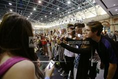 Visitors taking selfies with YouTube personality Sam Pepper (third right) at the Summer in the City festival, the UK's largest YouTube community event at Alexandra Palace in London. Picture date: Saturday August 9, 2014. Photo/ Yui Mok/PA Wire) (Press Association via AP Images)