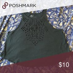 Roxy geometric cut out crop top. Looking for a crop top that isn't too cropped? This is the shirt for you. Roxy did it right with this cute tank! The geometric cut outs on the front of the shirt are see through and would look great with a bandeau (or an amazing push-up bra). The color is a gray-green. Looks great on any skin color. Roxy Tops Crop Tops