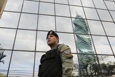 Police outside the Mossack-Fonseca offices in Panama City. The firm's leaked Panama Papers revealed how the world's wealthy and powerful used offshore companies to stash assets. Central And Eastern Europe, Central Asia, Guardian Uk, Us Attorney, Attorney General, Tax Haven, Voice Of America, Us Tax, Department Of Justice