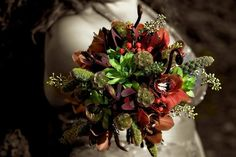 wedding bouquet with texture brown/red flowers- succulents, orchids, etc.   Wedding flowers by Sophisticated Floral Designs. Portland, OR http://sophisticatedfloral.com/ 2010
