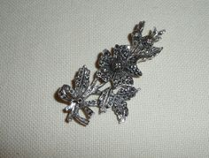 A Beautiful Marcasite Flower Spray Brooch / Pin  Circa 1940s  Sparkly marcasites set into a silver tone metal (probably Rhodium or Chrome plated)