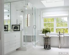 ELLE DECOR: The tub in the master bath is by Philippe Starck for Duravit, the cabinetry is custom made, and the flooring and walls are of Thassos marble