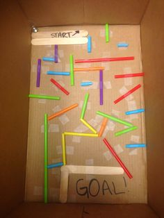 maze maker--copier paper box lid, straws, tape, marbles; also masking taped maze on floor & had kids blow a pom-pom through the maze with their straws