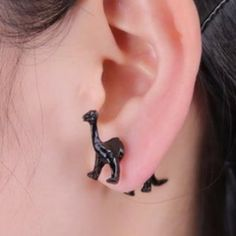 Dinosaur stereoscopic earrings- black brontosaurus Show your support for giving the Brontosaurus back his name! We can protest with fashion! Tiny 3D Brontosaurus makes quite the statement. Stereo scopic post earrings make for an unforgettable effect!!  Metal alloy. Black finish. Multiples available, so please comment below if you would like to purchase and I will create a personalized listing. Bundle for additional discounts!!! Jewelry Earrings