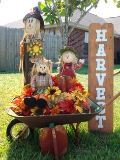 Fall is a favorite of mine. Recycled this old wheelbarrow I found on the side of the road. Sign is old fencing. Happy harvest!