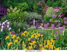 Enchanted Garden | Pond with flower garden. Schrieners Iris Gardens, Salem, Oregon ...