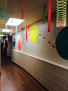 Great way to use simple items to create fun and interest to this hallway! Slinkys...large colorful circles and crepe paper streamers....Wow! We are all about some G-Force at Trinity UMC in Prattville, AL! cokesburyvbs.com