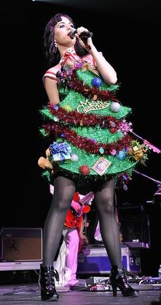 The Pop Princess Christmas Tree: Katy PerryWhat do you do when you're a famous pop star on tour who can't be home to enjoy your Christmas tree? Wearing one seemed liked the perfect solution for Katy Perry!