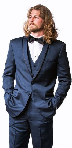 Don't know who he is. A model for sure. It's the hair, the beard and the suit. I've always like a man with a lot of hair.