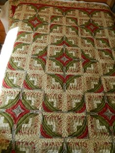 A Different Log Cagin - the piecing of this LC is unusual, but the curved quilting makes the blocks look as if they were pieced curved and adds so much movement to the quilt. Pattern is from a book called Hill and Valley Log Cabin.