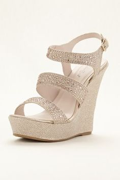 """This everyday on trend wedge will become a staple in any closet! Open toe wedge sandal features dazzling glitter fabric embellished with rhinestones along straps. Ankle strap with adjustable buckle ensures a comfortable fit. Heel measures 5 1/4. Platform measures1 1/2"""". Manmade cushioned sole. Fully lined. Imported by Coloriffics."""