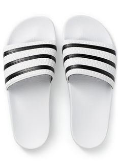 62d56ace3a8f0d White-and-black Adilette slides. Adidas SlidesAdidas OriginalsShoe
