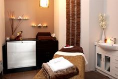 Massage room. I like the candles on the wall